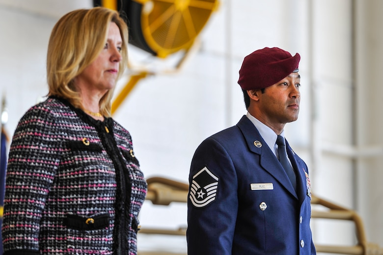 Secretary of the Air Force Deborah Lee James and Master Sgt. Ivan Ruiz, a pararescueman from the 56th Rescue Squadron, Royal Air Force Lakenheath, England, listen to the award citation during an Air Force Cross ceremony at the Freedom Hangar on Hurlburt Field, Fla., Dec. 17, 2014. During a 2013 deployment to Afghanistan, Ruiz protected injured special operations forces with fire support and provided emergency medical care under intense enemy fire in the dark, directly resulting in two U.S. lives saved. The last six Air Force Crosses have all been awarded to AFSOC Special Tactics Airmen.  (U.S. Air Force photo/Airman 1st Class Jeff Parkinson)