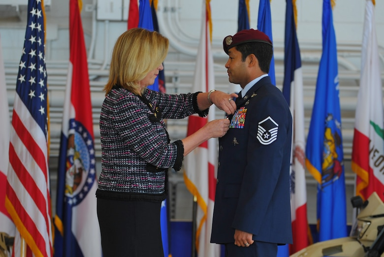 Secretary of the Air Force Deborah Lee James pins the Air Force Cross to the uniform of Master Sgt. Ivan Ruiz, a pararescueman from the 56th Rescue Squadron, Royal Air Force Lakenheath, England, during a ceremony at the Freedom Hangar on Hurlburt Field, Fla., Dec. 17, 2014. While deployed to Afghanistan with the 22nd Expeditionary Special Tactics Squadron, Ruiz protected his injured special operations forces teammates with fire support and provided emergency medical care under intense enemy fire in the dark, Dec. 10, 2013. The last six Air Force Crosses have all been awarded to AFSOC Special Tactics Airmen. (U.S. Air Force photo/Senior Airman Christopher Callaway)