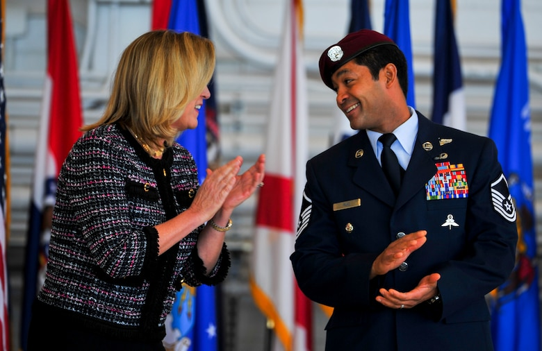 Secretary of the Air Force Deborah Lee James congratulates Master Sgt. Ivan Ruiz, a pararescueman from the 56th Rescue Squadron, Royal Air Force Lakenheath, England, on receiving the Air Force Cross at the Freedom Hangar on Hurlburt Field, Fla., Dec. 17, 2014. Ruiz is the sixth U.S. military member to receive the nation's second highest military decoration since 9/11. The last six Air Force Crosses have all been awarded to AFSOC Special Tactics Airmen. (U.S. Air Force photo/Senior Airman Christopher Callaway)
