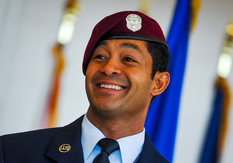 Master Sgt. Ivan Ruiz, smiles after being presented the Air Force Cross for extraordinary heroism in combat during a ceremony Dec. 17, 2014, on Hurlburt Field, Fla. The Air Force Cross is the second highest U.S. military decoration a member of the Air Force can receive. Ruiz is a pararescueman from the 56th Rescue Squadron, Royal Air Force Lakenheath, England. (U.S. Air Force photo/Senior Airman Christopher Callaway)