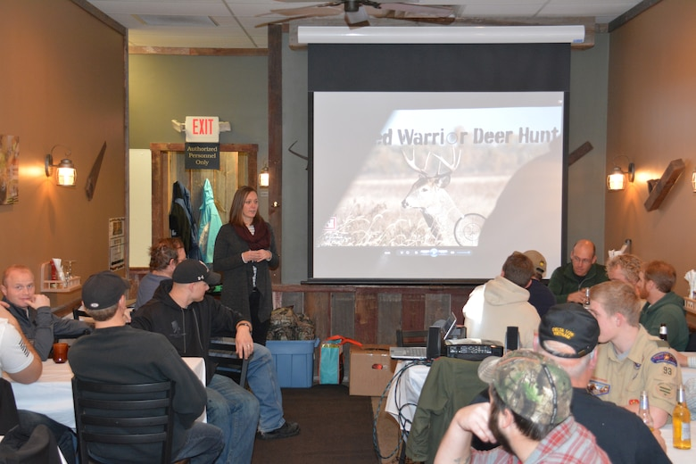 SPRING VALLEY, Wis. – Kelli Phillips, Eau Galle Recreation Area manager, talks about honoring veterans during a dinner with Corps employees, veterans and hunters Dec. 12. The group gathered at the Eau Galle Recreation Area, near Spring Valley, Wis., Dec. 13, for the third annual deer hunt. The Corps partnered with the Wounded Warrior Project and the Wisconsin Department of Natural Resources to host the event. The goal was to connect veterans with other veterans and honor them for their service while also managing the deer herd in the recreation area.