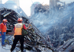 Tom Niedernhofer, wearing the structures specialist vest, stands at Ground Zero during recovery efforts at the fallen World Trade Center, New York City, in 2001. Niedernhofer is the U.S. Army Corps of Engineers urban search and rescue program manager.