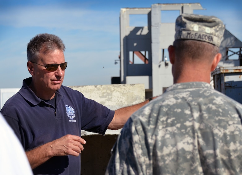 Tom Niedernhofer, U.S. Army Corps of Engineers urban search and rescue program manager, tours the disaster training facility at Moffett Field, California, with Col. Eric McFadden, Corps South Pacific Division deputy commander, Oct. 29, 2014.