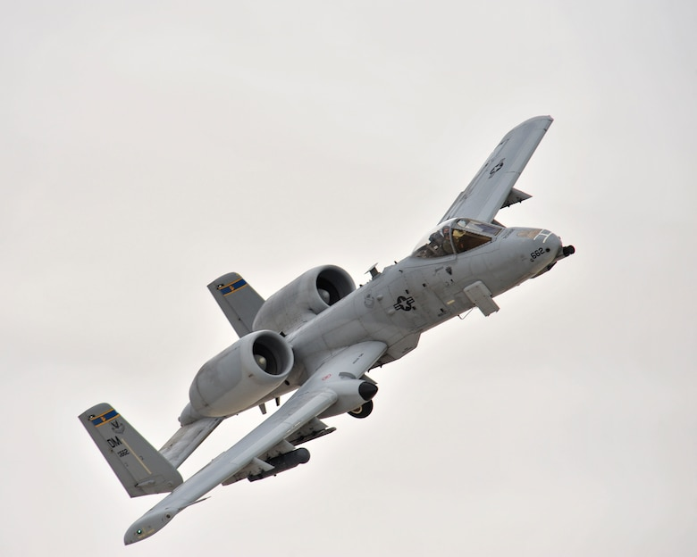 An A-10C Thunderbolt II from Davis-Monthan Air Force Base, Ariz., flies overhead during a training flight at White Sands Missile Range, N.M., Dec. 3, 2014.  The austere conditions of the missile range allow for pilots to get a close simulation of a deployed environment.  (U.S. Air Force photo by Airman 1st Class Chris Massey/Released)