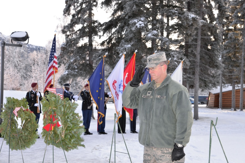 "Air Force Col. Brian Bruckbauer, commander of Joint Base Elmendorf-Richardson and 673d Air Base Wing places a wreath at Fort Richardson National Cemetery Dec. 13 during the local observance of ""Wreaths Across America,"" a nationwide program honoring fallen veterans each holiday season. (U.S. Air Force photo/Song Johnson)"