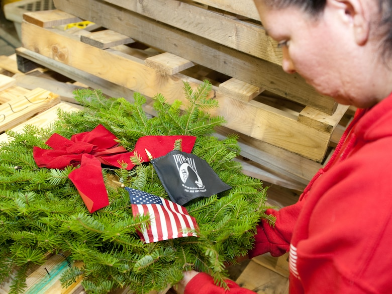 More than 10 organizations and dozens of volunteers took part in the annual Wreaths Across America event at the National Cemetery in Bourne, Massachusetts on December 13,2014. Together, all involved layed more than 4,400 wreaths on the graves of those buried in the cemetery.