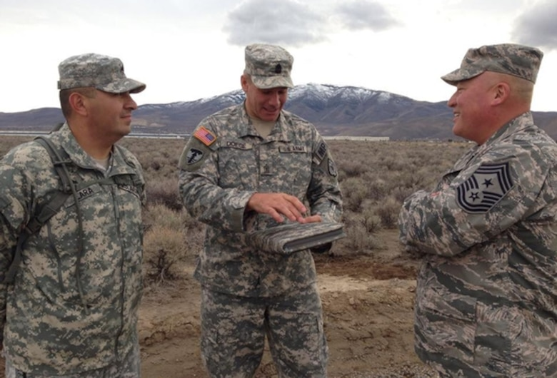 Air Force Chief Master Sgt. Mitchell Brush, right, the senior enlisted advisor to the chief of the National Guard Bureau, meets with Nevada Army Guard Soldiers 1st Sgt. Elbie Doege, center, and Staff Sgt. Rutilio Lara in Reno in early December.  Photo courtesy NV ARNG 106th Public Affairs Detachment