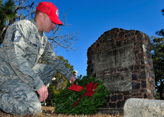 Master Sgt. Ryan Blumberg, 823rd RED HORSE expeditionary manpower management course instructor, lays a wreath on a veterans grave Dec. 13 at the Mount Hope Cemetery in Lynn Haven, Fla. Blumberg laid the wreath as part of the Wreaths Across America Day event, that pays respect and honor to military members that have fallen. (U.S. Air Force photo by Airman 1st Class Sergio A. Gamboa)