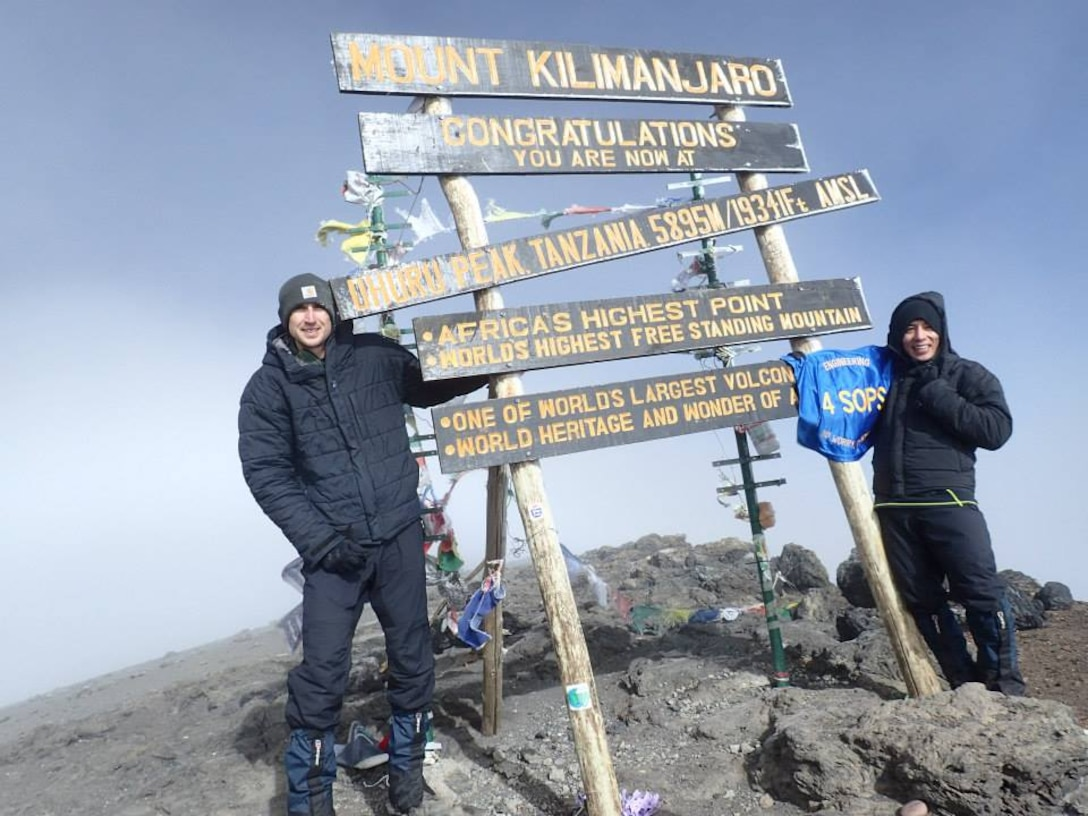 Capt. Rodrigo Ocampo, 4th Space Operations Squadron spacecraft engineer, shows his 4 SOPS pride after reaching the summit of Mount Kilimanjaro along with his friend John Gaebler in early October. (Courtesy photo)
