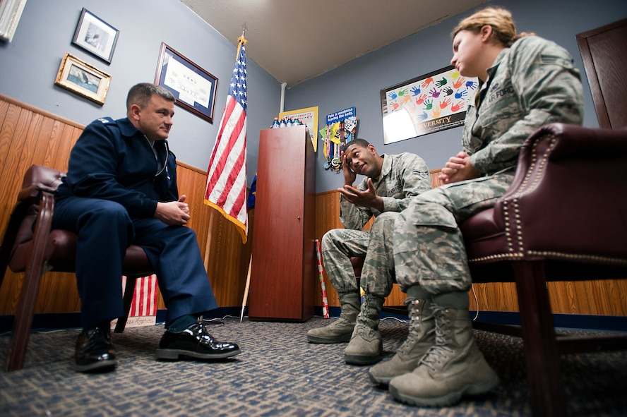 Chaplain (Capt.) Jason, Klodnicki, a 99th Air Base Wing chaplain, helps coworkers find a solution to their problems during a counseling session at Nellis Air Force Base, Nev., Dec. 12, 2014. The Nellis chapel will be hosting a relationship seminar Jan. 9, open to all ID card holders -- whether they're single, married, divorced or wanting to improve coworker relationships -- from 6 to 9 p.m. at the Nellis Club. Contact the chapel at 702-652-2950 for sign up information. (U.S. Air Force photo by Senior Airman Timothy Young)