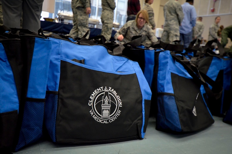 U.S. Airmen with the 128th Air Refueling Wing volunteered to help pass out gifts to patients at the Clement J. Zablocki VA Medical Center, Milwaukee Dec. 10, 2014.  (U.S. Air National Guard photo by Tech. Sgt. Jenna Lenski/Released)