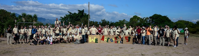 Volunteers gather for a photo during the 58th Chapel Hike in the village of Mira Valle, La Paz, Honduras, Dec. 13, 2014. As part of the 58th Chapel Hike, over 130167 members assigned to Joint Task Force-Bravo trekked over three miles to help deliver over 3,5002,500-pounds of donated dry goods to villagers in need. Since the chapel hikes originated in 2007, over 9,700 service members have donated over $170,000 and volunteered their time to deliver more than 209,000 pounds of food and supplies to several remote villages. (U.S. Air Force photo/Tech. Sgt. Heather Redman)