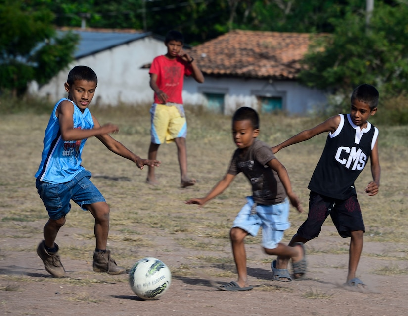 Children play with donated soccer balls in the village of Mira Valle, La Paz, Honduras, Dec. 13, 2014. The soccer balls were donated by the non-profit organization Kick for Nick Foundation. As part of the 58th Chapel Hike, over 130 167 members assigned to Joint Task Force-Bravo trekked over three miles to help deliver over 3,5002,500-pounds of donated dry goods to villagers in need. Since the chapel hikes originated in 2007, over 9,700 service members have donated over $170,000 and volunteered their time to deliver more than 209,000 pounds of food and supplies to several remote villages. (U.S. Air Force photo/Tech. Sgt. Heather Redman)