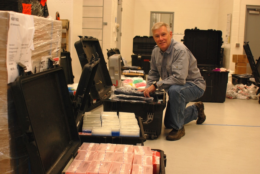 Dr. Randal J. Schoepp with the U.S. Army Medical Research Institute of Infectious Diseases at Fort Detrick, Md., inspects packing cases filled with laboratory supplies.