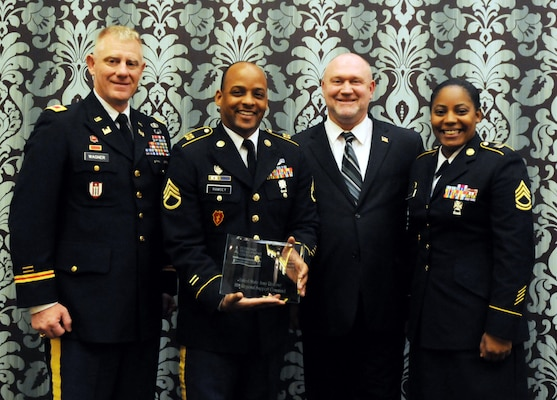 Standing with Michigan City, Ind., Mayor Ron Meer after being presented a Business Investment Award during the Economic Development Corporation of Michigan City's 2014 Business Investment Awards Celebration, are Col. Kurt Wagner, 88th Regional Support Command; Staff Sgt. Antoine Ramsey; and Sgt. 1st Class Angel Avery, 624th Quartermaster Company.