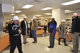 Team members tour the new, sleek dining facility at the hospital Dec. 4, 2014.