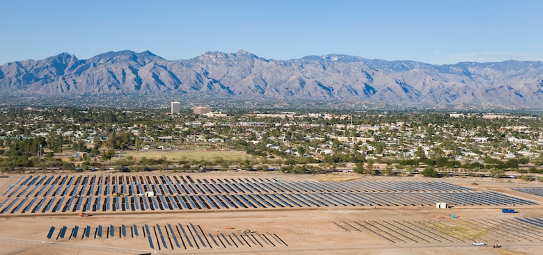 Solar panels at Davis-Monthan Air Force Base, Ariz., collect sunlight. The Davis-Monthan solar array project, on 170 acres of underutilized land, makes it the largest of its kind on any Defnese Department installation. (U.S. Air Force photo/1st Lt. Sarah Ruckriegle)