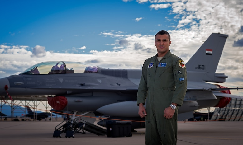 Iraqi air force captain Hama stands in front of one of the IAF F-16 Fighting Falcons Dec. 16, 2014 at Tucson International Airport, Ariz. Hama helped deliver one of the IAF's new F-16Ds to their training location. (U.S. Air Force photo/Senior Airman Jordan Castelan)