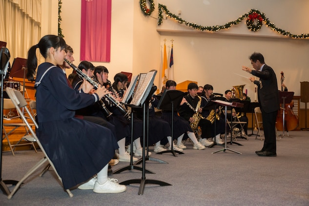 Students from Higashi Junior High School perform during the holiday concert, Dec. 15, 2014, held at the Marine Memorial Chapel aboard Marine Corps Air Station Iwakuni, Japan. The concert was held for students from Higashi Junior High School, Agenosho Elementary School and Matthew C. Perry Schools.