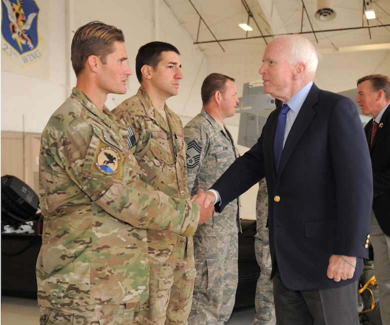 U.S. Air Force Staff Sgt. Lorin Schlecht, 48th Rescue Squadron survival, evasion, resistance and escape specialist, shakes hands with Sen. John McCain at Davis-Monthan Air Force Base, Ariz., Dec. 18, 2014. Sens. McCain and Jeff Flake, as well as Rep. Paul Gosar of Arizona, were visiting several military installations across Arizona, throughout the day.  (U.S. Air Force photo by Airman 1st Class Chris Drzazgowski)