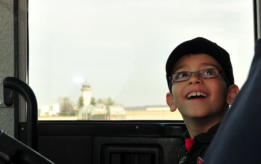 The 121st Air Refueling Wing hosted eight year old Roman Pettograsso for their inaugural pilot for a day program Dec 11, 2014, at Rickenbacker Air National Guard Base, Ohio. (U.S. National Guard photo by Airman 1st Class Wendy Kuhn/released)