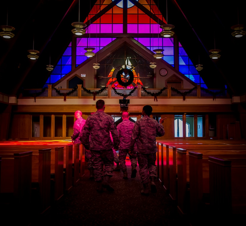Col. Jeffrey DeVore, Joint Base Charleston commander, and Chief Master Sgt. Mark Bronson, 628th Air Base Wing command chief, are led through the Chapel at JB Charleston - Air Base, S.C. The tour was part of an initiative to show JB Charleston leadership a closer look at various missions throughout JB Charleston. (U.S. Air Force photo / Senior Airman Tom Brading)