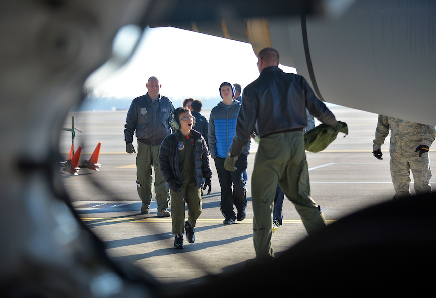 The 121st Air Refueling Wing hosted eight year old Roman Pettograsso for their inaugural pilot for a day program Dec 11, 2014, at Rickenbacker Air National Guard Base, Ohio. (U.S. Air National Guard photo by Master Sgt. Ralph Branson/Released)