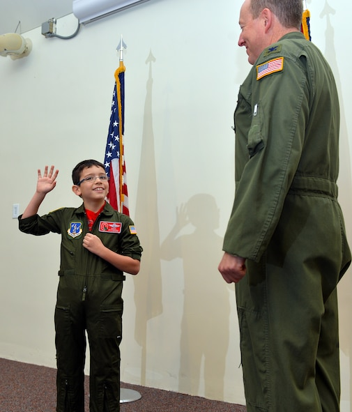 U.S. Air Force Col. Joseph Schulz swears in 8-year-old Roman Pettograsso to be the pilot for a day Dec 11, 2014, at Rickenbacker Air National Guard Base, Ohio. (U.S. Air National Guard photo by Master Sgt. Ralph Branson/Released)