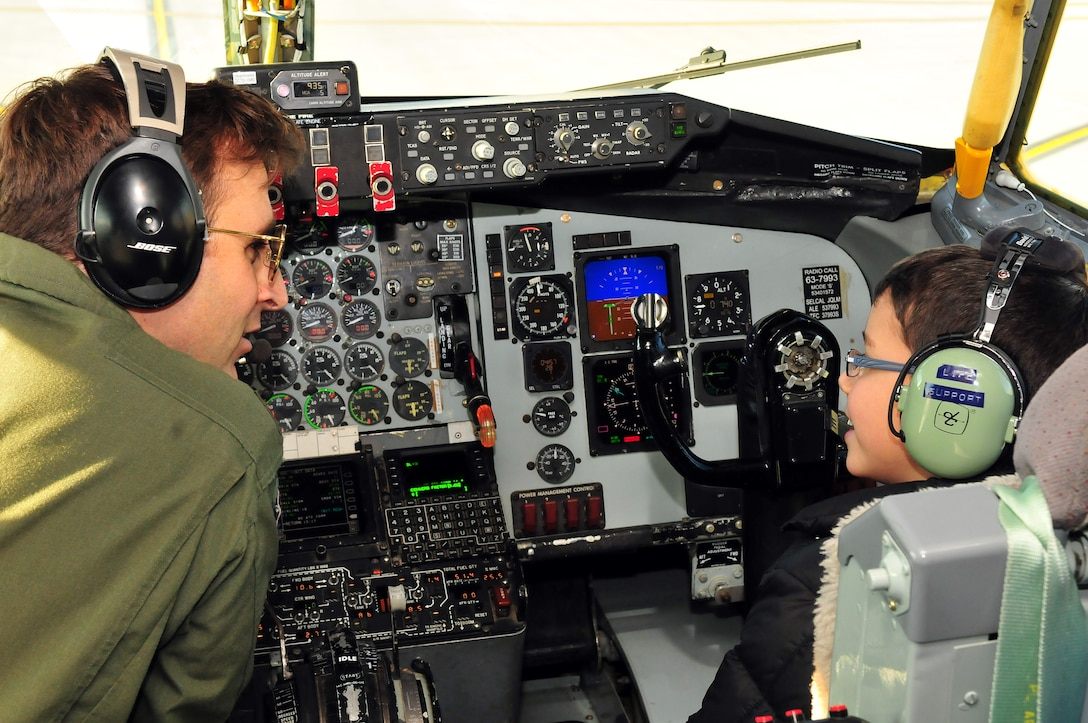 U.S. Air Force Major Joe Uehlin gets help preflighting a KC-135 from Roman Pettograsso, the 121st ARW honorary pilot for a day Dec 11, 2014 at Rickenbacker Air National Guard Base. (U.S. Air National Guard photo by Airman 1st Class Wendy Kuhn)