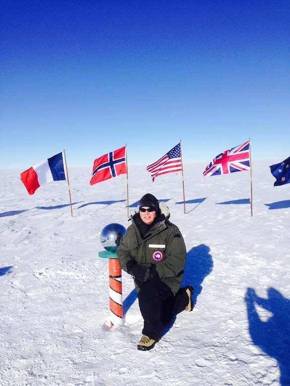 Chief Master Sgt. James W. Hotaling, the Air National Guard command chief master sergeant, poses at the geographic South Pole. Hotaling was there meeting deployed Airmen from the New York ANG's 109th Airlift Wing, who provide Airlift capability for the U.S. Antarctic Program throughout the Antarctic continent. (courtesy photo)