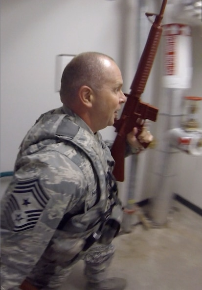 Chief Master Sgt. James W. Hotaling, the Air National Guard command chief, secures a facility with security forces Airmen at Clear Air Force Station, Alaska, Nov. 3, 2014. Hotaling was at the installation to meet with ANG Airmen and talk about issues they face as Guardsmen. (U.S. Air National Guard photo by Senior Master Sgt. Adrianne Schulz)