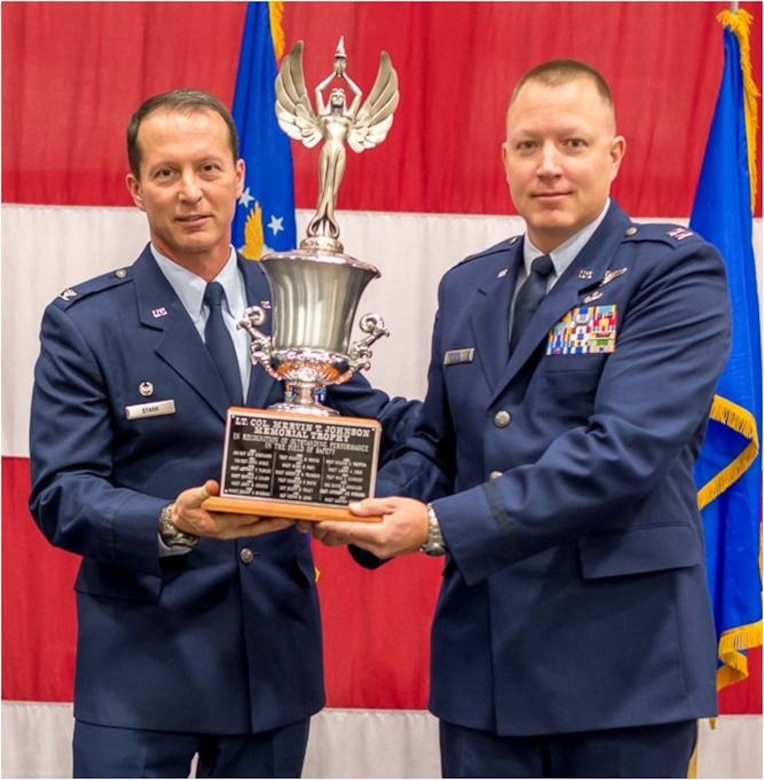 Capt. Thomas Dorsett of the 192nd Airlift Squadron accepts the Safety Award from the 152nd Airlift Wing Commander, Col. Karl Stark, at the Nevada Air National Guard's Annual Awards Ceremony on December 7, 2014.USAF photo by Maj. Kristoffer Pfalmer RELEASED.