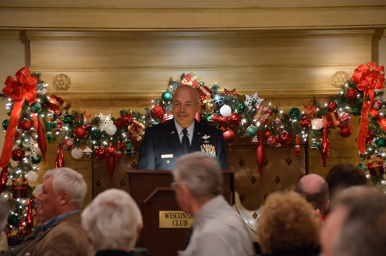 Col. Daniel S. Yenchesky, the wing commander of the 128th Air Refueling Wing delivers a speech at the 128th Community Council general membership meeting held at the Wisconsin Club, Milwaukee Friday, Dec. 12, 2014. Yenchesky's presentation focused on his recent deployment and the 128 ARW's missions and impact on the global scene. Yenchesky's speech at the general membership meeting reminded the community members in attendance that the 128 ARW is still a vital part of the local community and the missions overseas. (U.S. Air National Guard photo by Maj. Sherri A. Hrovatin/Released)