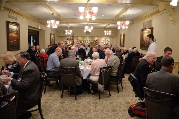 U.S. Airmen with the 128th Air Refueling Wing and 128th Community Council members enjoy lunch at the Wisconsin Club, Milwaukee, Dec. 12, 2014 before the quarterly 128th Community Council general membership meeting. (U.S. Air National Guard photo by Maj. Sherri A. Hrovatin/Released)