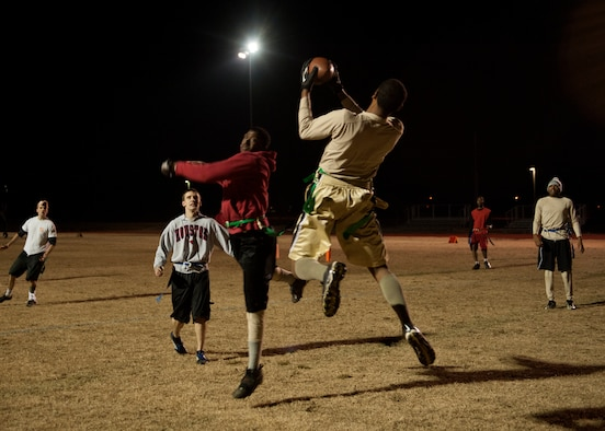 A receiver from the 19th Maintenance Squadron intramural football team #2 completes a touchdown pass Dec. 10, 2014, at Little Rock Air Force Base, Ark. The 19th MXS # 2 and #3 battled it out, team #2 won 27-21. (U.S. Air Force photo by Airman 1st Class Scott Poe)