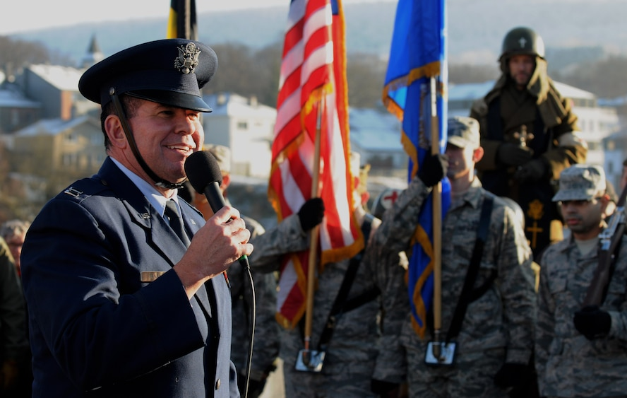 U.S. Air Force Chaplain (Capt.) Sean Randall, 52nd Fighter Wing chaplain, speaks during a Battle of the Bulge memorial ceremony at Vielsalm, Belgium, Dec. 14, 2014. Randall delivered the invocation for two out of the three events throughout the day. (U.S. Air Force photo by Airman 1st Class Luke Kitterman/Released)