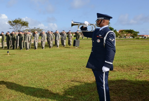 Airman 1st Class Anthony Smith-Nelson plays taps during the Operation Linebacker II Remembrance Ceremony Dec. 18, 2014, at Andersen AFB, Guam. The ceremony commemorated the 75 Airmen that lost their lives during the operation including 33 who were lost from 15 downed B-52 Stratofortress bombers. Smith-Nelson is a member of the Andersen Air Force Base Honor Guard (U.S. Air Force photo/Staff Sgt. Robert Hicks)