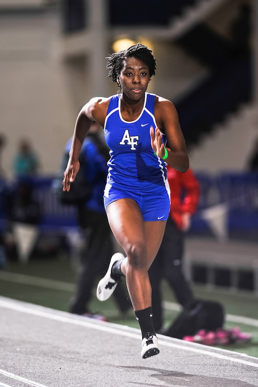 "Funmi Akinlosotu gathers speed during the long jump event at the Air Force Track and Field Holiday Open at the Academy's Cadet Field House's indoor track Dec. 12, 2014. Akinlosotu, a freshman at the Academy, finished third at 35'5"". (U.S. Air Force photo/Liz Copan)"