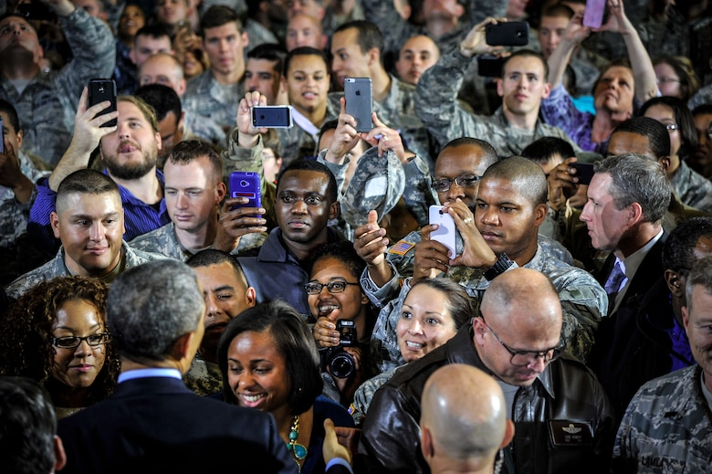 Service members and Defense Department civilians shake hands and take photos of President Barack Obama Dec. 15, 2014, at Joint Base McGuire-Dix-Lakehurst, N.J. The president visited the joint base and addressed a crowd of more than 3,000 people to express his gratitude to service members and DOD civilians for their service. (U.S. Air Force photo/Staff Sgt. Scott Saldukas)