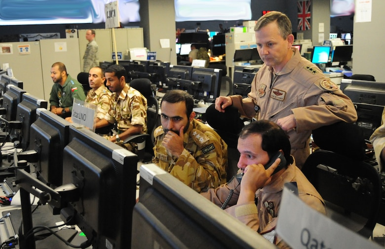 Lt. Gen. John Hesterman III looks on as Gulf Cooperation Council liaison officers participate in an exercise at the Combined Air Operations Center, Nov. 26, 2014, at Al Udeid Air Base, Qatar. Hesterman is the U.S. Air Forces Central Command commander. Screens in the photo have been blurred for operational security purposes. (U.S. Air Force photo/Staff Sgt. Chelsea Browning)