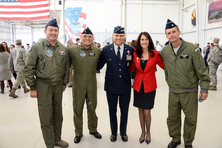 Lt. Gen. Chris Nowland, 12th Air Force (Air Forces Southern) commander, and his wife Kristan pose for a photo with the Air Forces Southern Liason Officers at Davis-Monthan AFB, Ariz., Dec. 19, 2014. 12th Air Force (Air Forces Southern) is responsible for the combat readiness of eight active-duty wings, including the 355th Fighter Wing also located at Davis-Monthan AFB, and one direct reporting unit. These subordinate commands operate more than 650 aircraft with more than 55,000 uniformed and civilian Airmen. (U.S. Air Force photo by Staff Sgt. Adam Grant/Released)
