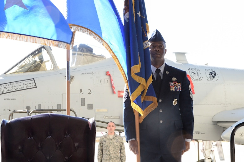 Chief Master Sgt. Calvin Williams, 12th Air Force (Air Forces Southern) Command Chief, holds the 12th AF guidon during a change of command ceremony at Davis-Monthan AFB, Ariz., Dec. 19, 2014. During the ceremony, Lt. Gen. Tod Wolters relinquished command to Lt. Gen. Chris Nowland. (U.S. Air Force photo by Staff Sgt. Adam Grant/Released)