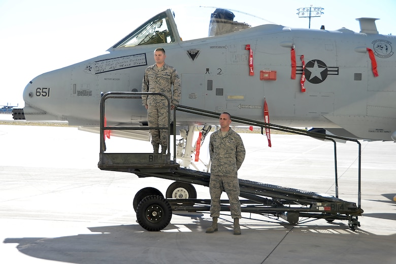 Staff Sgt. Charles Buchanan, 355th Aircraft Maintenance Squadron Dedicated Crew Chief and Airman 1st Class Mark Bryan, 355th Aircraft Maintenance Squadron Assistant Crew Chief, unveil Lt. Gen. Chris Nowland's aircraft during the 12th Air Force (Air Forces Southern) ¬ change of command at Davis-Monthan AFB, Ariz., Dec. 19, 2014. Lt. Gen. Tod Wolters relinquished command to Lt. Gen. Chris Nowland. (U.S. Air Force photo by Staff Sgt. Adam Grant/Released)