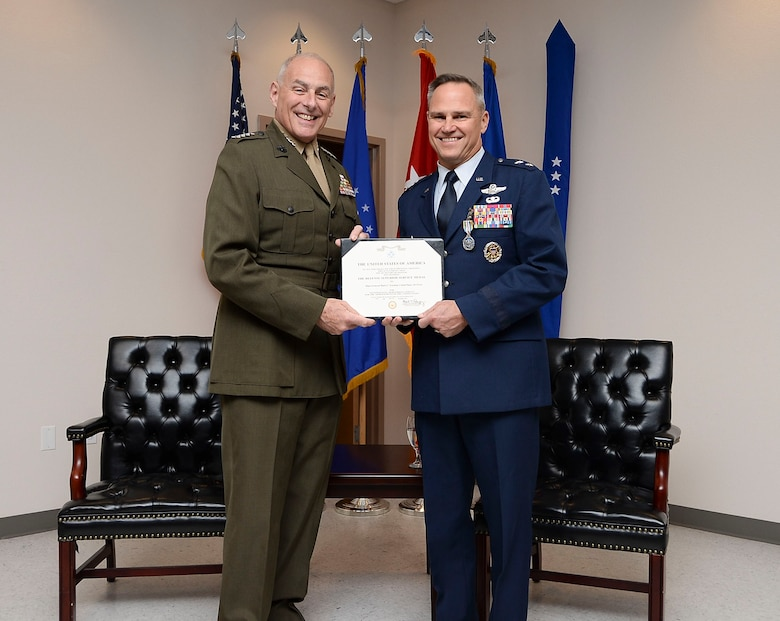 Gen. John Kelly, United States Southern Command Commander, presents then Maj. Gen. Chris Nowland, 12th Air Force (Air Forces Southern) incoming commander, with the Defense Superior Service Medal at Davis-Monthan AFB, Ariz., Dec. 19, 2014. The Defense Superior Service Medal is a senior decoration awarded to members of the United States Armed Forces who perform superior meritorious service in a position of significant responsibility. (U.S. Air Force photo by Staff Sgt. Adam Grant/Released)