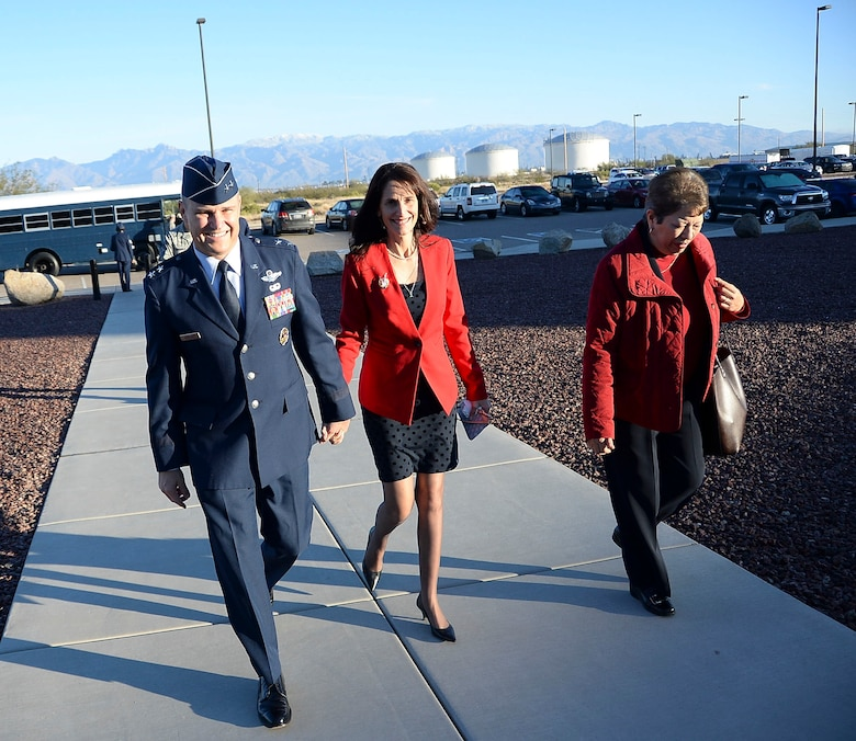 Maj. Gen. Chris Nowland, 12th Air Force (Air Forces Southern) incoming commander, and his wife Kristan walk together towards the 43rd Electronic Combat Squadron at Davis-Monthan AFB, Ariz., Dec. 19, 2014. Nowland was promoted to the rank of Lt. Gen. in a ceremony held at the 43rd ECS. (U.S. Air Force photo by Staff Sgt. Adam Grant/Released)