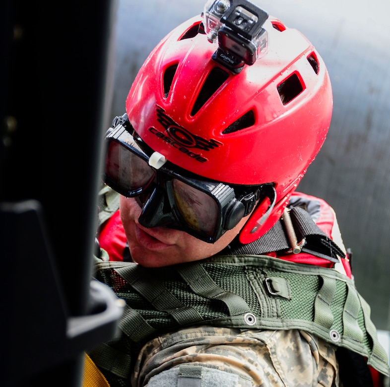 A medic from the 1-228th Aviation Battalion climbs in to a UH-60 Black Hawk helicopter after being lowered to retrieve a rescue mannequin in Lake Yojoa, Honduras, Dec. 18, 2014.   The 1-228th AVN BN spent the afternoon practicing overwater hoist training.  The overwater hoist training was held to ensure members of Joint Task Force-Bravo are planning and preparing for crisis and contingency response as part of U.S. Southern Command's mission. Contingency planning prepares the command for various scenarios that pose the greatest probability of challenging our regional partners or threatening our national interests.  (U.S. Air Force photo/Tech. Sgt. Heather Redman)
