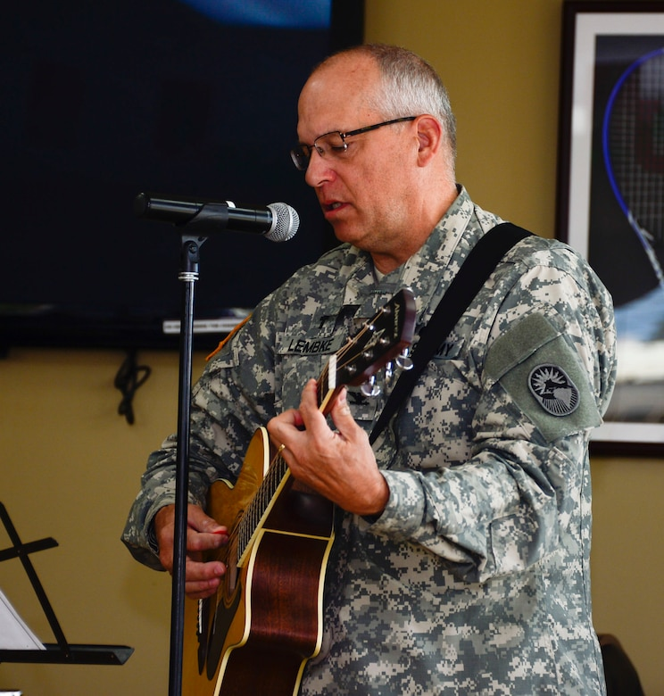 U.S. Army Col. Michael Lembke, U.S. Southern Command chaplain plays the guitar and sings during the December Prayer Breakfast at the Dining Facility, on Soto Cano Air Base, Honduras, Dec. 18, 2014.  (U.S. Air Force photo/Tech. Sgt. Heather Redman)