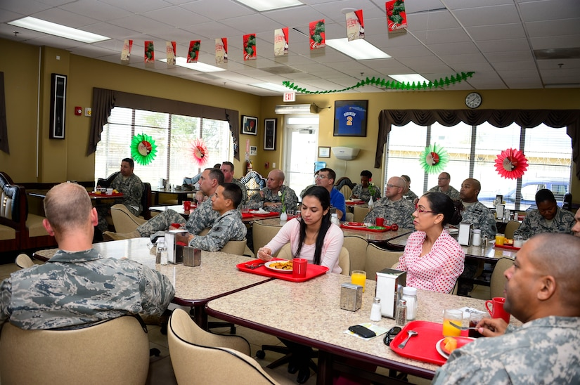 Members of Joint Task Force-Bravo listen to U.S. Army Col. Michael Lembke, U.S. Southern Command chaplain's message during the December Prayer Breakfast at the Dining Facility, on Soto Cano Air Base, Honduras, Dec. 18, 2014.  (U.S. Air Force photo/Tech. Sgt. Heather Redman)