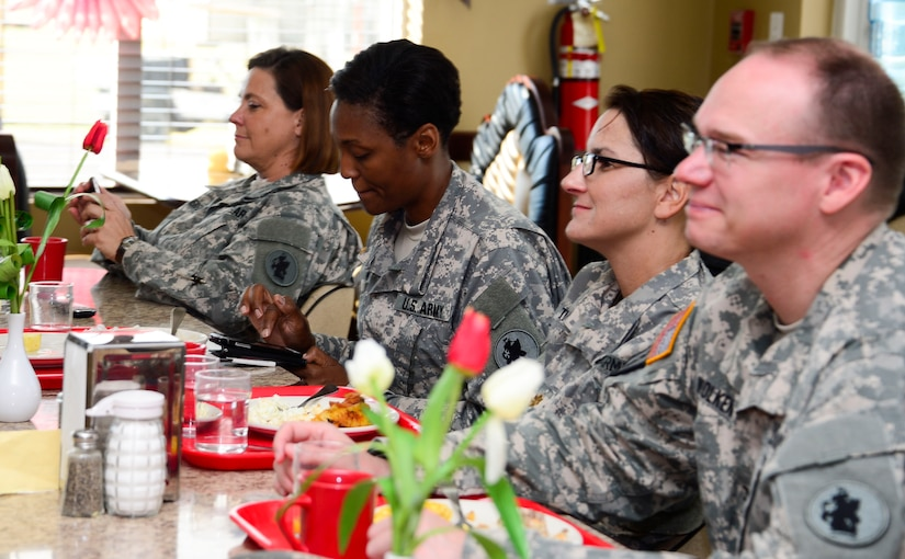 Members of Joint Task Force-Bravo's Medical Element eat breakfast and listen to U.S. Army Col. Michael Lembke, U.S. Southern Command chaplain's message during the December Prayer Breakfast at the Dining Facility, on Soto Cano Air Base, Honduras, Dec. 18, 2014.  (U.S. Air Force photo/Tech. Sgt. Heather Redman)