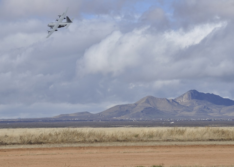 A C-130 from the 94th Airlift Wing, Dobbins Air Reserve Base, flies at a low altitude during training exercises in Arizona on Dec. 17, 2014. The pilots flying the plane were from the 700th Airlift Squadron. (U.S. Air Force Photo by Senior Airman Miles Wilson)